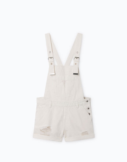 SHORT DUNGAREES WITH RIPS