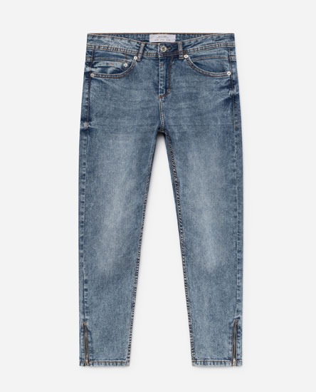 JEANS WITH ZIPPED HEMS