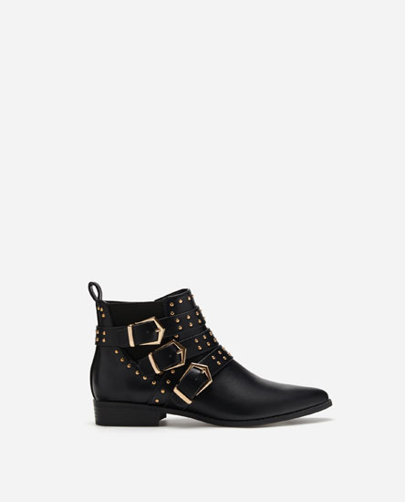 MULTI-BUCKLE FLAT ANKLE BOOTS