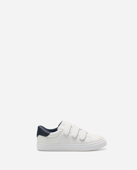 WHITE PLIMSOLLS WITH HOOK-AND-LOOP STRAPS