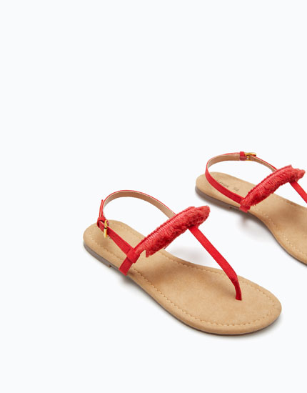 SANDALS WITH FRINGED UPPERS