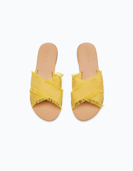 SANDALS WITH FRAYED CROSSOVER STRAPS