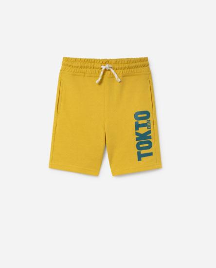 Plush bermuda shorts with slogan