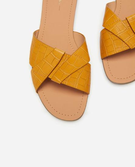 Criss-cross flat sandals.