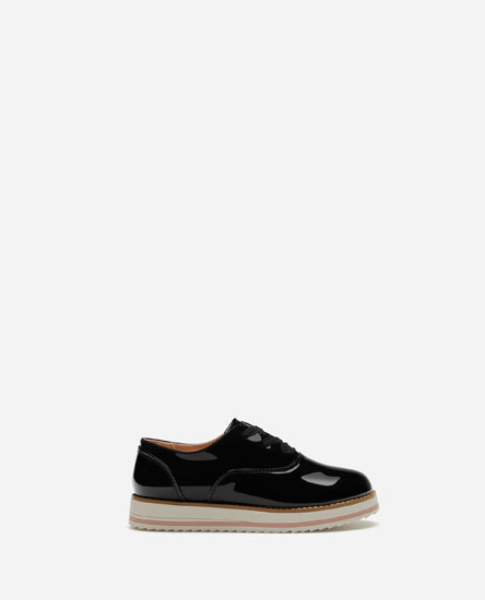 Black faux patent leather shoes