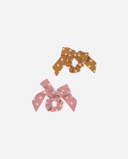 Pack of polka dot scrunchies with bow