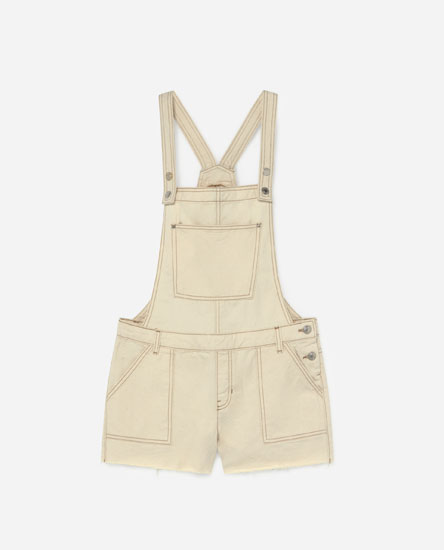 Short dungarees with frayed hems