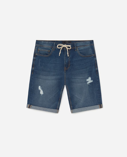 Skinny denim Bermuda shorts with rips