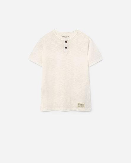 Camiseta botóns