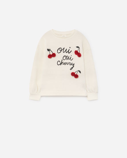 Printed sweatshirt with pompoms
