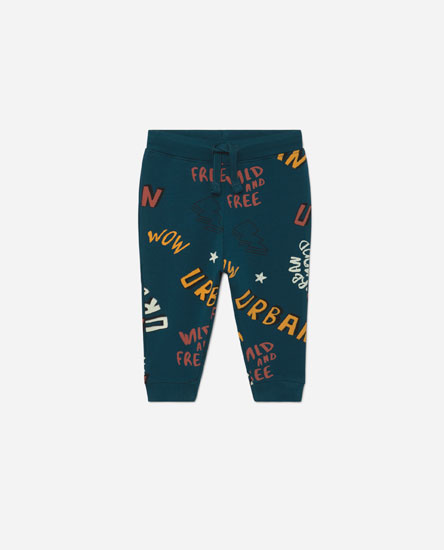 Graffiti print trousers