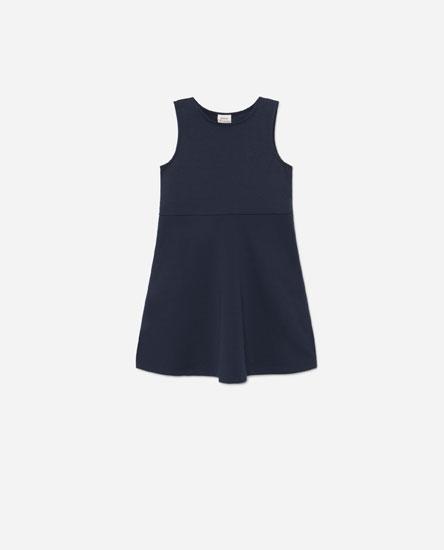 Sleeveless dress with flared skirt