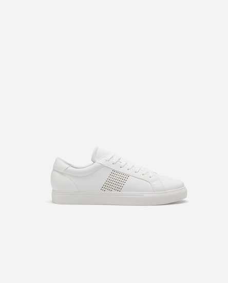 Sneakers with perforated stripe.