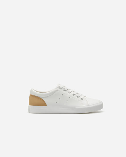 Plimsolls with sand-coloured heel