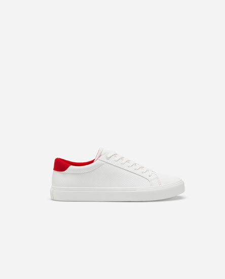 Microperforated plimsolls with red heel tab