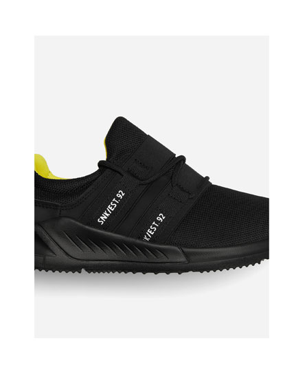 Side slogan trainers