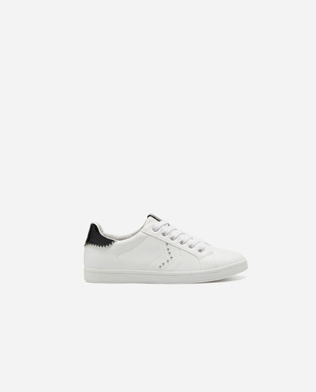 Plimsolls with heel studs