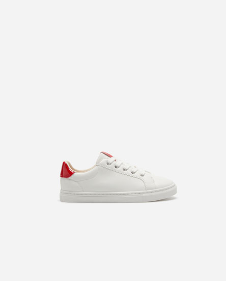 Basic plimsolls with red heel tab