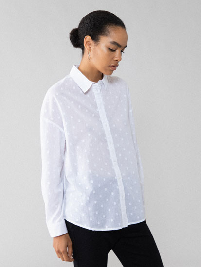 Shirt with a textured polka dot design