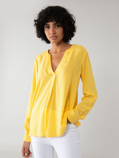 Shirt with a crossover V-neckline