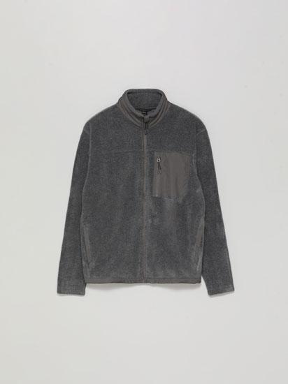 Jaqueta polar amb butxaca combinada
