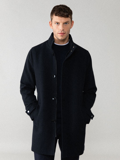 Coat with textured fabric