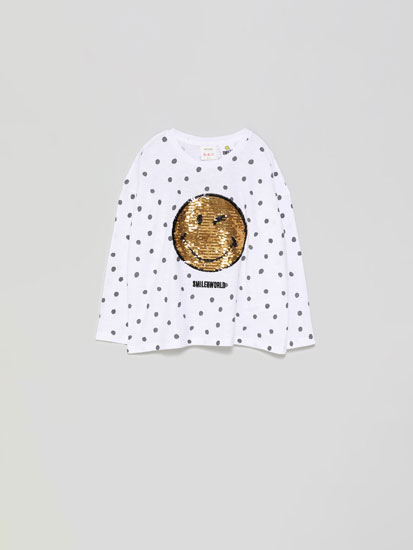 Smiley face T-shirt with reversible sequins