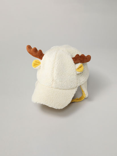 Faux shearling cap with reindeer horns