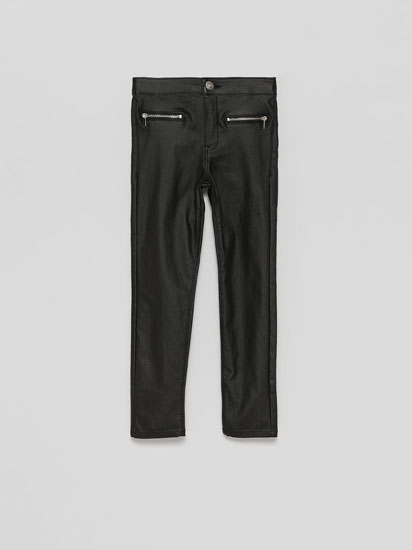 Waxed trousers with zips