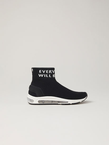 Sock-style sneakers with slogan