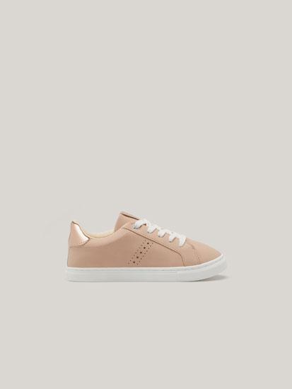 Sneakers with metallic heel