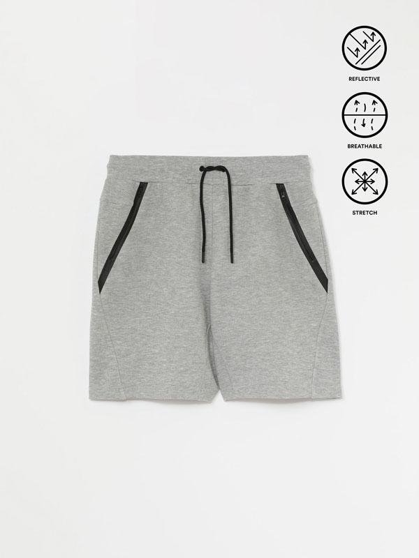 Sporty Bermuda shorts with pockets