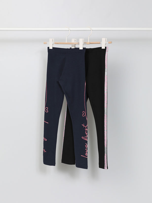Pack of 2 leggings with shiny print on the sides.