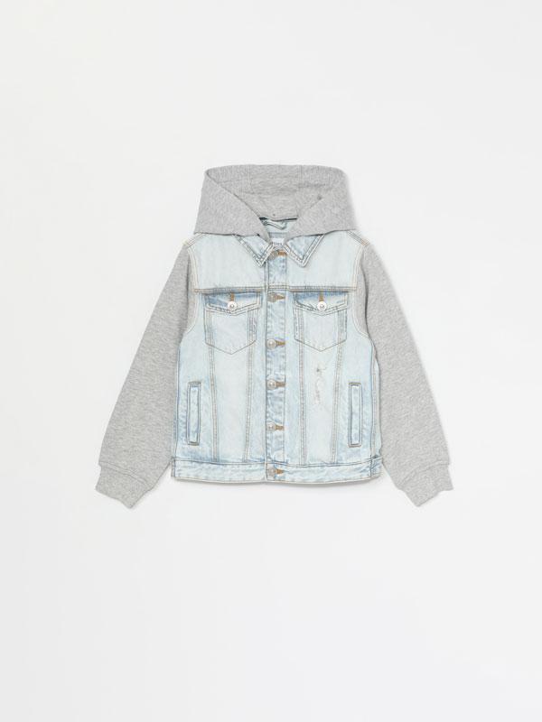 Denim jacket with plush sleeves