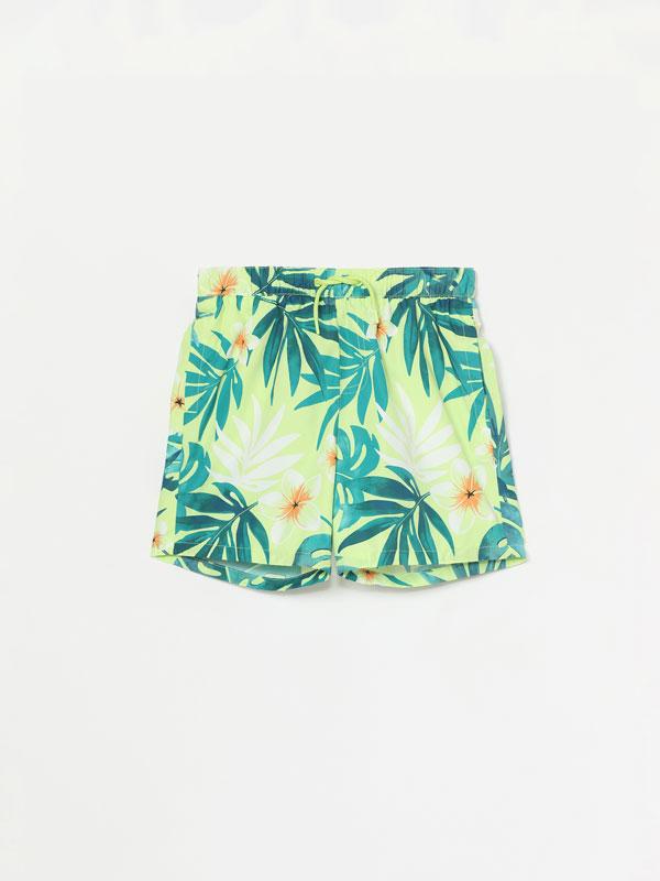 Tropical print swimming trunks