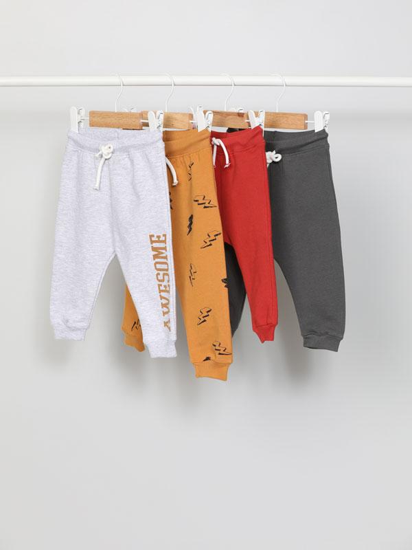 Paquet de 4 pantalons de xandall bàsics en llis i estampat