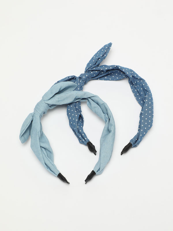 Pack of 2 denim headbands with bow.