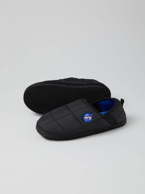 Padded NASA house slippers