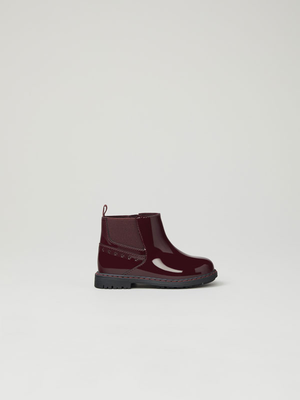 Faux-patent-finish stretch boots