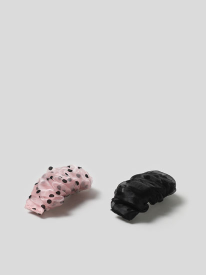 Pack of 2 hair clips with a polka dot print.