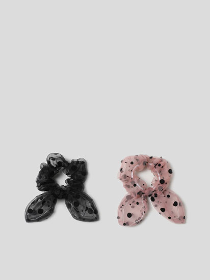 Pack of 2 scrunchies with a polka dot print.