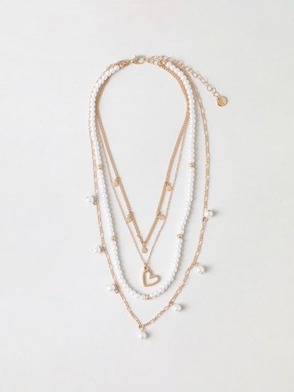 Multi-strand necklace with faux pearls and heart pendant